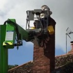 Removal from chimney, using a cherry-picker